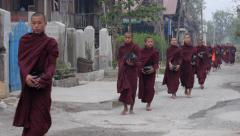 Buddhist Monks Collecting Alms in Nyaungshwe, Shan State, Myanmar (Burma) Stock Footage
