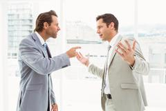 Business colleagues in argument at office Stock Photos