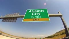 Driving on highway/interstate,  exit sign of the atlantic city, new jersey Stock Footage