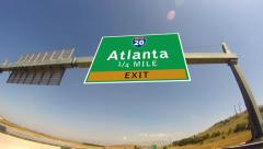 Driving on highway/interstate,  exit sign of the city of atlanta, gorgia Stock Footage