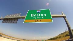 Driving on highway/interstate,  exit sign of the city of boston, massachusett Stock Footage