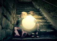 children holding bright sun on stairs - stock photo
