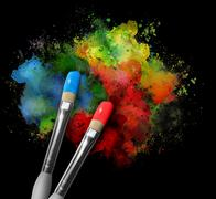 Paintbrushes with paint splatters on black Stock Photos