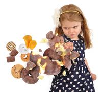Child punching unhealthy junk food snakes on white Stock Photos