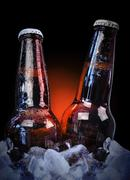 ice cold class beer bottles on black - stock photo