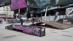 Teenage performing bmx and rollerskates tricks on street Stock Footage