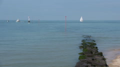 Pier and boats at the coast of Trouville, France Stock Footage