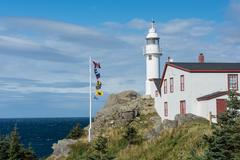 lobster cove head lighthouse in gros morne national park, newfoundland and la - stock photo
