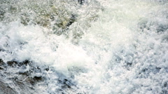 Fast flowing Transparent mountain water power unpolluted texture - stock footage