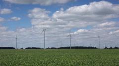 Windmill turbines in farm field in Midwest Stock Footage