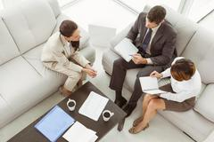 Couple in meeting with financial adviser at home - stock photo