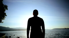 Young Female Silhouette Celebrating New Day City Harbor Backdrop Sunrise - stock footage