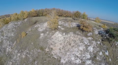 Aerial view. Flying over the rocky hill, autumn landscape. Stock Footage
