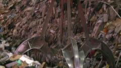 Closeup of Claw Picking Up Trash Stock Footage