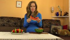 Pregnant girl eat watermelon in room, pregnancy cause meal whim Stock Footage