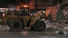 Bulldozer Pushing Trash in Waste Facility Stock Footage