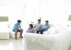 Family sitting in living room Stock Photos