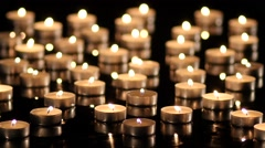 Many Candles light on black background Stock Footage