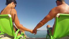 Happy romantic couple in bikini enjoying beautiful hoeymoon at the beach Stock Footage