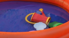 Orange inflatable paddling pool with water Stock Footage