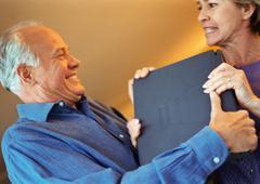 Mature couple fighting over laptop, portrait Stock Photos