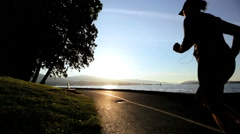 Young Female Caucasian Running Practice Sunrise City Parkland Track Fitness - stock footage