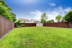 Spacious fenced backyard with shed Stock Photos