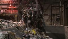 Claw Dropping Trash into Furnace Stock Footage