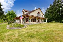 american farm house exterior with large land - stock photo