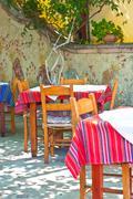chairs at Greek tavern - stock photo