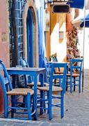 chairs and table at Greek tavern - stock photo