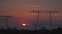 Sunrise with fog and electric poles-timelapse Stock Footage