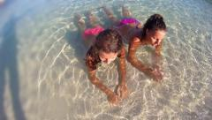 Portrait smiling girls in bikini enjoying being alone by ocean on beach vacat Stock Footage