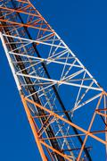 Communications tower with antennas on blue sky Stock Photos