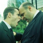Two businessmen, head to head, side view. Stock Photos