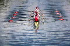 eight men rowing - stock photo