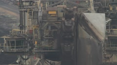 Detail of a bucket-wheel excavator in an open pit mine - stock footage