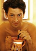 Bare-chested man having breakfast, close-up, portrait Stock Photos
