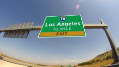 driving on highway/interstate,  exit sign of the city of los angeles, califor - stock footage