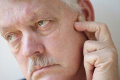 Man with pain near his ear Stock Photos