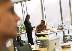 Businessmen talking in office. Stock Photos