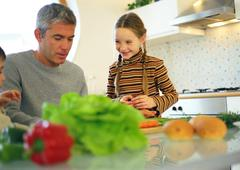 Father and daughter in kitchen Stock Photos