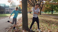 Athletic Urban Joggers Finish Warming Up And Start Running Stock Footage