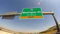 Driving on highway/interstate,  exit sign of the city of washington dc, virgi Stock Footage