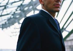 Portrait of businessman, partial view Stock Photos