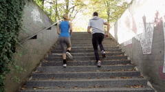 Athletic Urban Joggers Run Up The Stairs Stock Footage