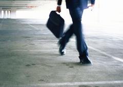 Businessman walking, lower section, blurred - stock photo