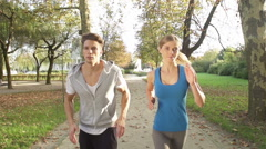 Good-Looking Young Couple Ends Up Their Jogging With High Five - stock footage