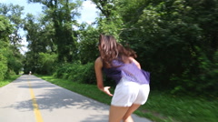 Young attractive woman rollerblading in park on a beautiful sunny day. Stock Footage