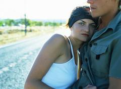 Couple hugging, woman looking at camera Stock Photos